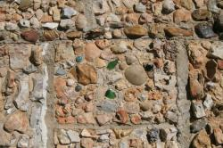 Stones that Mrs. Quigley began collecting as a girl assumed and important part of the house. Working tenderly for three years, Mrs. Quigley covered the outside walls with a collection of fossils, crystals, arrowheads and stones selected from the creak beds for their beauty. A perennial garden surrounds the house.